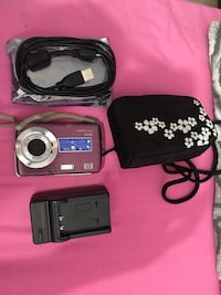 HP camera with cable and battery