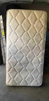 quilted white and gray floral mattress