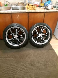 4 newer rims by RTX. With mud+snow tires.
