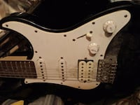 white and black electric guitar little out of tune but works great Burlington