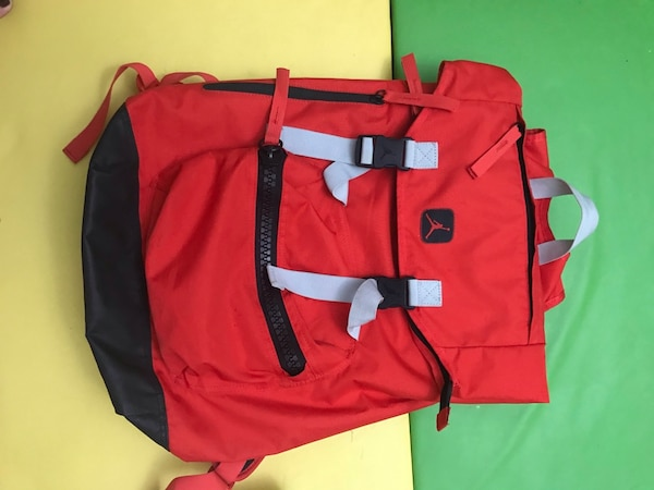 Big red back pack 66b68f0e-86d6-4b37-906d-6f0360de7fe6