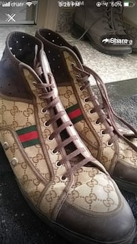 Pair of gray-and-black gucci sneakers Winnipeg, R3E 2R4