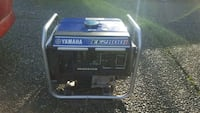 black and blue Coleman Powermate portable generator 3753 km
