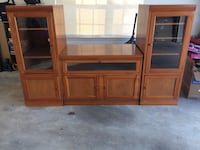 Very nice entertainment center with lots of storage. Custom built 3 piece light cherry stained wood.  Foley, 36535