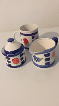 Two white-and-blue ceramic mugs