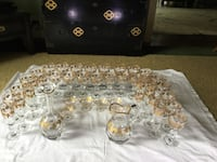 gold-and-clear glass pitcher and drinking glass lot