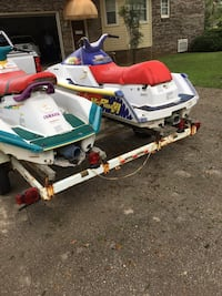 two white personal watercraft's