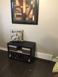 Refurbished 2-tier bench/toy box. Black exterior and light gray inside. Wheels under make it really easy to move around. They can be removed to make it steady. Also nice for foyer bench for shoes, mitts, hats. St Catharines, L2P 3K9