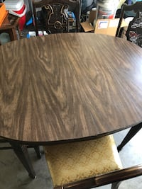 Round brown wooden dining table Hughesville, 20637