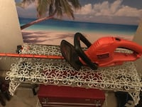 Red and black black & decker hedge trimmer Oklahoma City, 73162