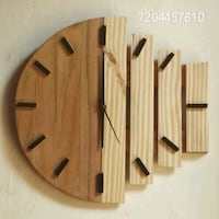 brown wooden wall clock with text overlay 13331 km