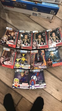 assorted-color action figure boxes 503 km