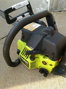 black and green Poulan chainsaw