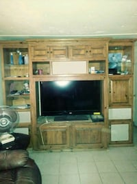flat screen television with brown wooden TV hutch Bakersfield, 93307