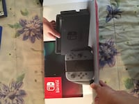 Black and gray nintendo switch with 4 games Toronto, M5A