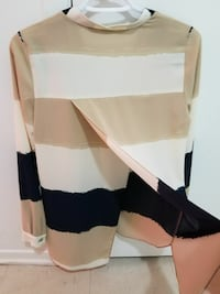 brown, white, and black striped long-sleeved shirt