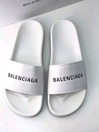pair of white leather slide sandals Toronto