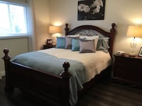 7 piece queen bedroom set featuring tall dresser, long dresser with mirror, 2 night stands, headboard, footboard and rails.