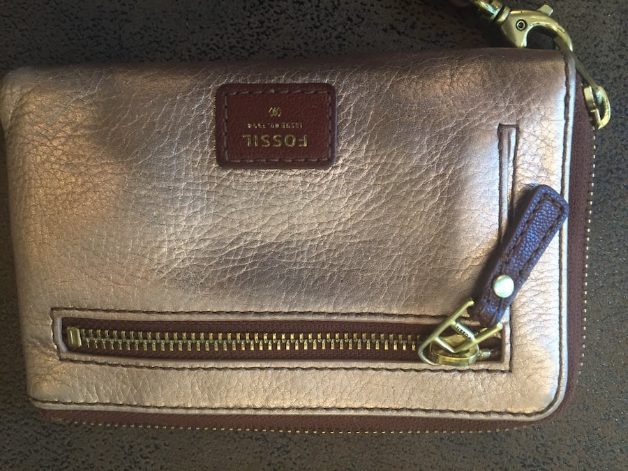 brown and gold fossil wristlet