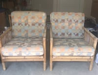 Set of two rattan (bamboo) chairs; fabric and cushions in good condition. No pets and no smoking.