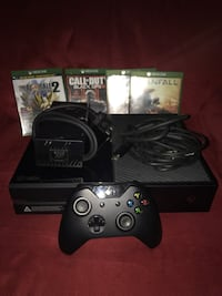 Black xbox one console with controller and game cases Bellmawr, 08031