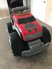 toddler's red, gray, and black plastic monster truck toy