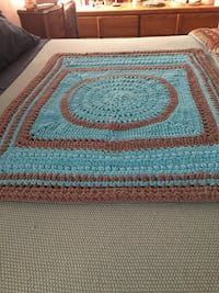 teal and brown knitted blanket