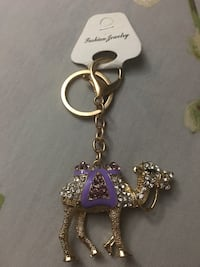Gold and purple diamond embellished camel keychain