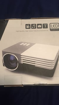 """30""""-100"""" projector with 150 lumens. It's awesome if you have the ability to have a really dark room to use it in. Unfortunately I have 3 Windows in the room it's for. You can make it portable for outside use on the garage with an external USB battery.  Highland Park, 60035"""
