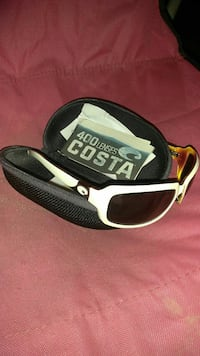 white framed Costa Del Mar sunglasses with clamp s