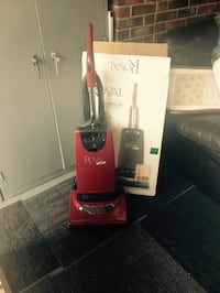 Red and black royal upright vacuum cleaner