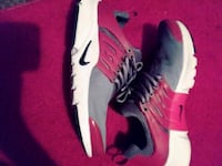 pair of white-and-red Nike sneakers Las Vegas, 89142