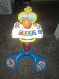 and blue Fisher-Price learning table