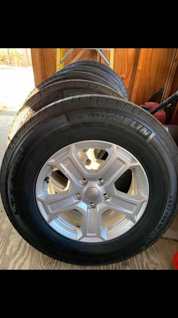 Photo (5) stock 2020 jeep wrangler sport tires and rims. Less than 50 miles