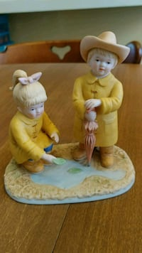 ceramic boy and girl wearing yellow tops ceramic figurine Logansport, 46947