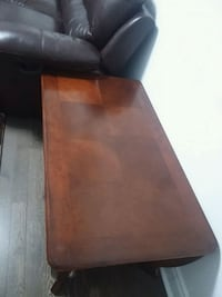 brown wooden framed brown leather padded chair