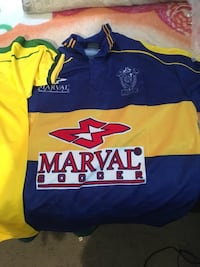 blue and yellow Marval Soccer jersey shirt