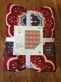 red, beige, and teal floral textile pack