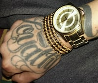 round gold-colored analog watch with link bracelet Winnipeg