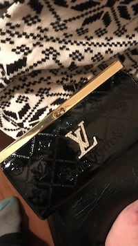 black and brown Louis Vuitton leather bag