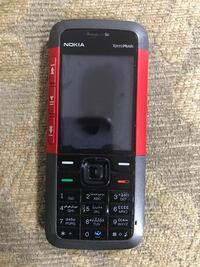 black and red Nokia candybar phone Delta, V4C 4J8