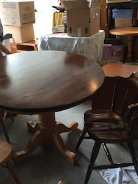 round brown wooden pedestal table with four chairs Port Moody, V3H 1S4