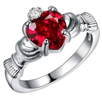 silver-colored ruby ring