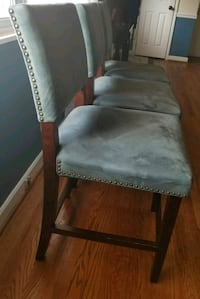 brown wooden framed gray padded chair 39 km