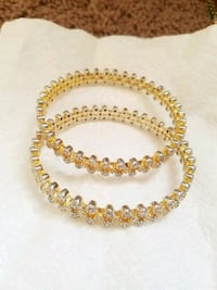 gold and white beaded bangles  Bristow