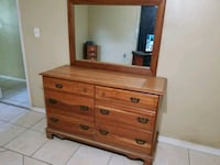 Nice all real wood dresser with mirror very heavy  Dunnellon, 34431