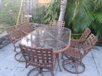 Patio -Rose gold frame glass top table and chairs Pompano Beach