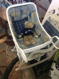 Antique wicker baby carriage and child's rocking chair