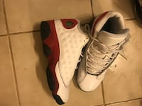 Pair of white-and-black air jordan 13 Cleveland