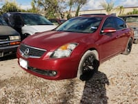 Red nissan altima sedan 2010 1206 mi